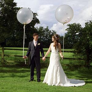Bride and Groom and Big Balloons - Wedding Videographer Kent