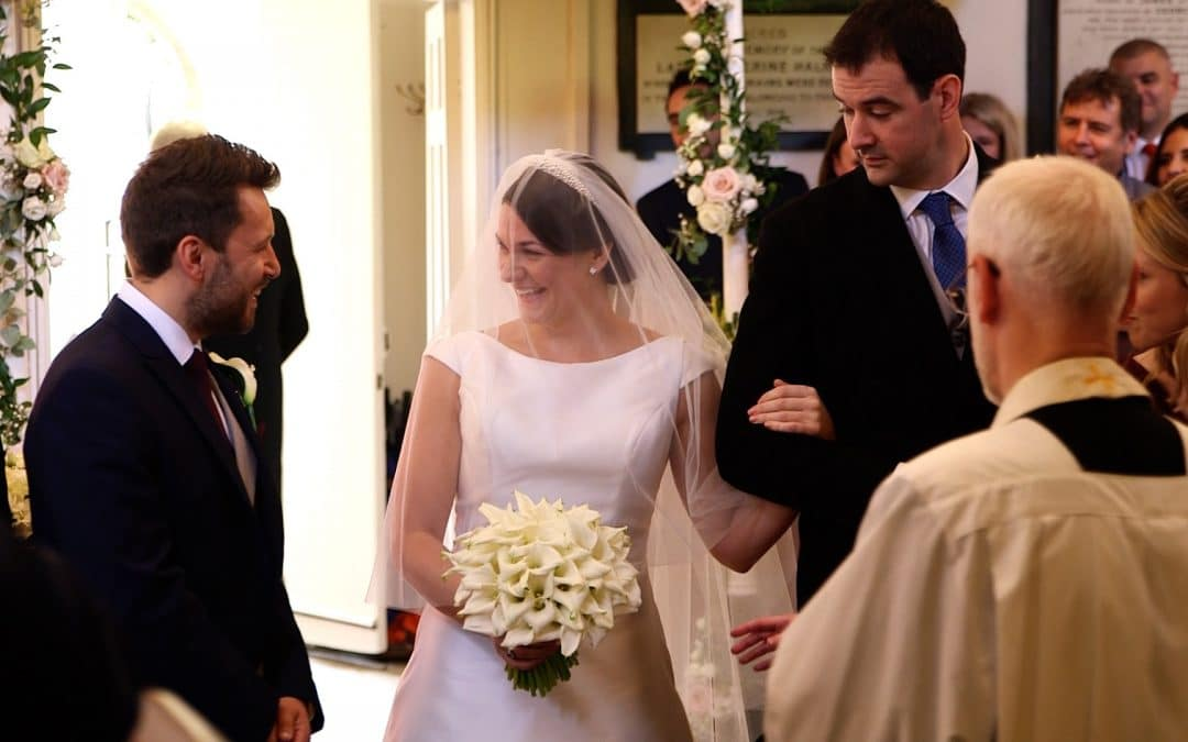 groom sees bride walk down aisle