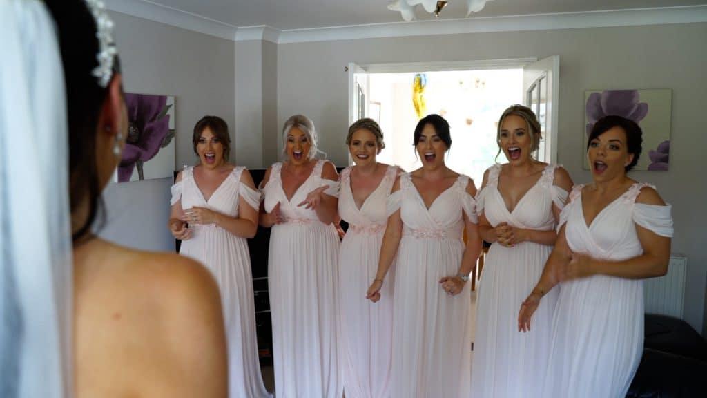 bridesmaids happy to see bride