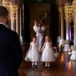 Flowergirls walking down the wedding aisle