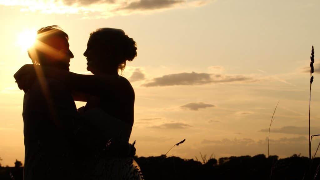 couple having their golden hour photos and wedding video