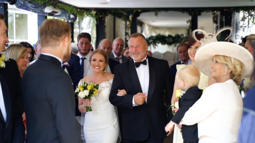 bride walking down aisle and seeing groom