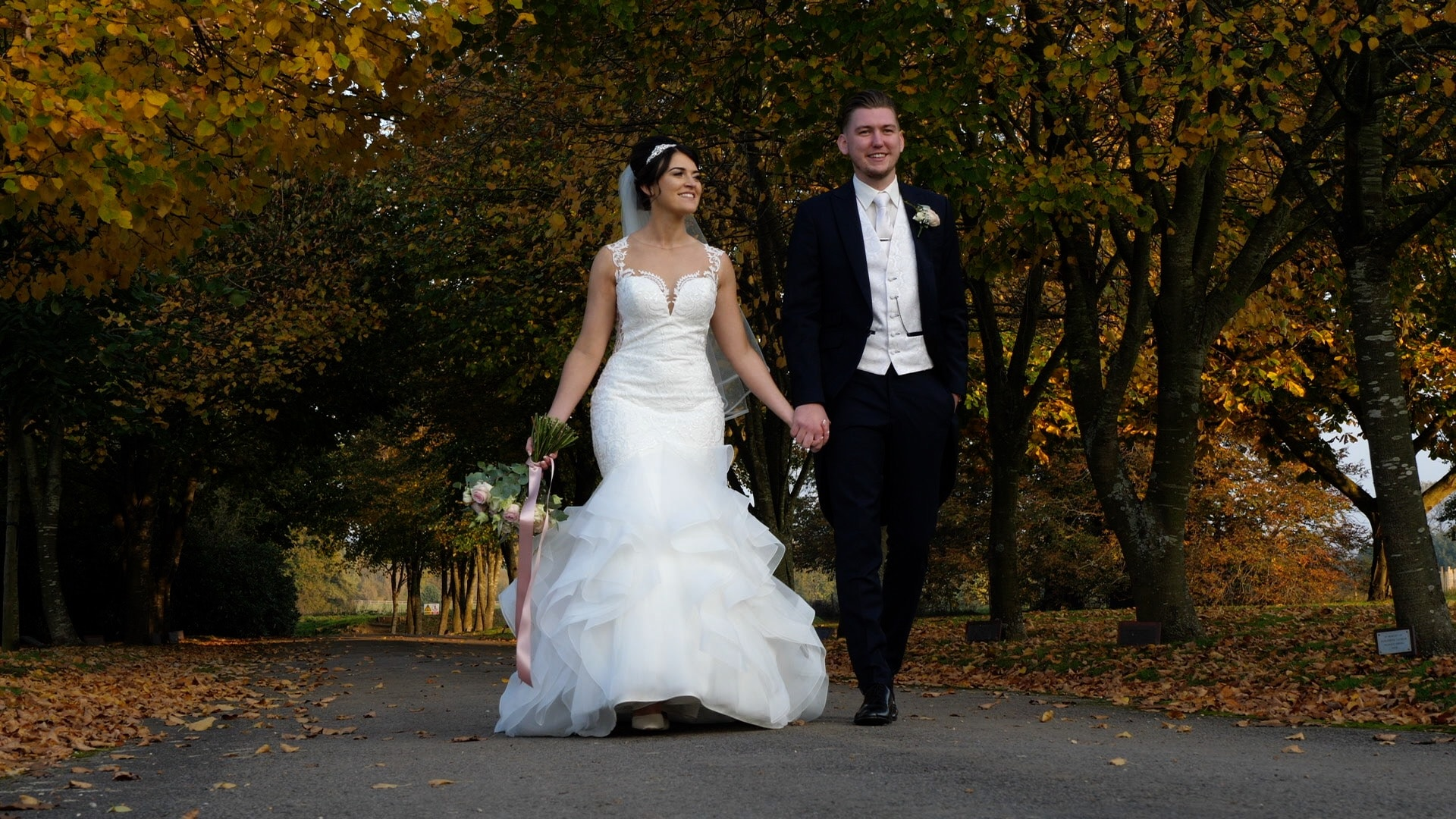 Bride and groom walking holding hands - Wedding Videographer for Intimate or Small Weddings